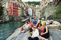 Students enjoy the wonder of Riomaggiore in Cinque Terra Naitonal Park a UNESCO World Heritage Site, Italy