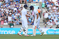 Joe Root of England congratulates Captain Alastair Cook of England after he reaches his 50 during the 3rd day of the Investec Ashes Test match between England and Australia at the Oval, London, United Kingdom on 22 August 2015. Photo by Phil Duncan.