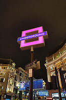 PlayStation 5 Launch 2020 Oxford Circus, London<br />  view of TFL's roundels that have been replaced with Playstation Control buttons for the X, triangle and square and the circle being TFL's standard roundel as TFL partners with Sony Playstation for the launch of the Playstation 5 console in Oxford Circus, London, England, UK