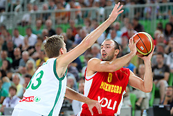 Zoran Dragic of Slovenia and Milos Borisov of Montenegro at friendly match between Slovenia and Montenegro for Adecco Cup 2011 as part of exhibition games before European Championship Lithuania on August 7, 2011, in SRC Stozice, Ljubljana, Slovenia. (Photo by Urban Urbanc / Sportida)