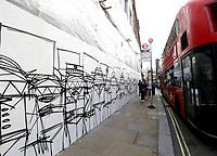 street artist Nathan bowen new art work  I AM A MAN' Shaftesbury Avenue london photo by Roger Alacron
