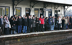 Embargoed to 0001 Thursday October 13 File photo dated 05/03/09 of commuters waiting on a platform due to delays, as rail passengers will be able to claim compensation when trains are more than 15 minutes late under plans announced by the Department for Transport (DfT).