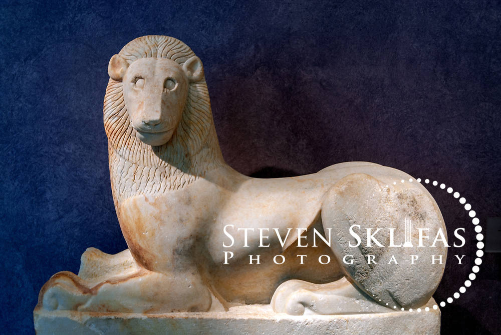 6th century BC marble lion at the Kerameikos museum. Athens. Greece. The archaic era funerary sculpture was found buried near the Sacred gate in 2002, together with the beautiful 2.10 metre high Kouros. Serving as a burial ground as long ago as the 12th century BC, Kerameikos located in the ancient neighbourhood of potters contains part of the ancient city walls and the Dipylon, the main gate of Ancient Athens at a junction of the Sacred Way and Panathenaic Way. It served as a burial ground for the richest and most distinguished citizens of the city.