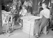 Young boys male apprentices learning glass blowing Finland, 1950s