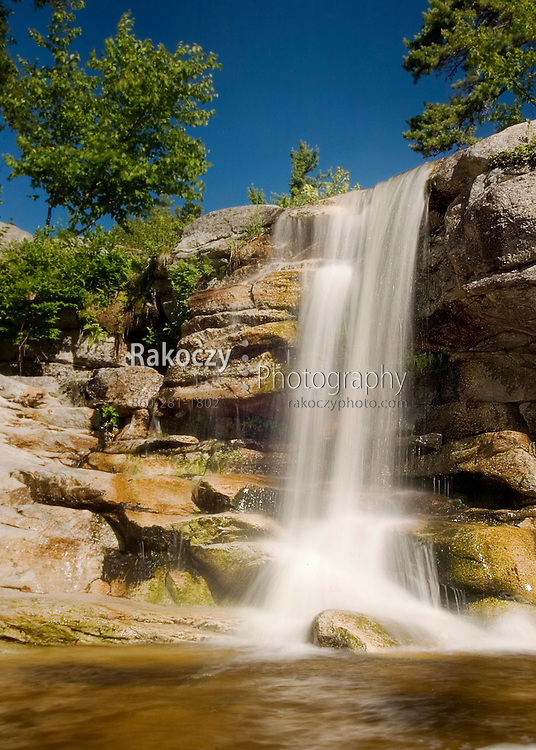 Cool mountain water rushes over a rocky ledge high in the Shawangunk Mountains of New York.