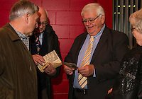 Merrill Fay and Paul Phelps look through old photographs during the reception for LHS Hall of Fame Inductees on Saturday evening at the Huot Technical Center.  Fay's father Wilbur Fay - Class of 1925 and Paul Phelps  1967-2002 were two of the inducties. (Karen Bobotas/for the Laconia Daily Sun)