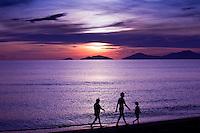 Walking along China Beach near Hoi An under stunning sunrise skies.