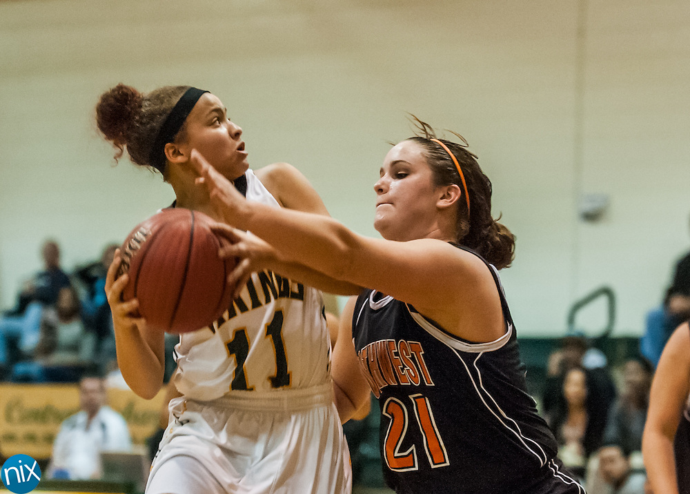 Central Cabarrus' Mahaley Holit goes up for a shot against Northwest Cabarrus' Bryana Hott Friday night at Central Cabarrus High School. Central won the game 53-48.