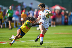 Brittany Benn of Canada evades the tackle of Thalia Costa of Brazil <br /> <br /> Photographer Craig Thomas/Replay Images<br /> <br /> World Rugby HSBC World Sevens Series - Day 2 - Friday 6rd December 2019 - Sevens Stadium - Dubai<br /> <br /> World Copyright © Replay Images . All rights reserved. info@replayimages.co.uk - http://replayimages.co.uk