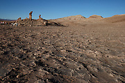 Tourists gather around the Tres Marias (three Marys), in Valle de la Luna (the Valley of the Moon) in Chile's Atacama Desert