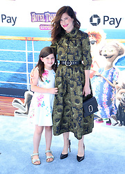"""Kathryn Hahn and her daughter Mae Sandler at the premiere of """"Hotel Transylvania 3: Summer Vacation"""" held at the Westwood Village Theatre in Los Angeles"""
