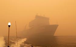 HMAS Choules off the coast of Mallacoota, Victoria during the bush fire crisis.