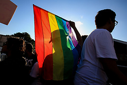 June 17, 2017 - Colombo, Sri Lanka - A Sri Lankan man(M) is silhouetted against the rainbow flag  at Colombo, Sri Lanka on Saturday 17 June 2017. ..In celebration of Colombo Pride 2017, a ' Rainbow Bus Parade ' was held with the participation of Sri Lankan LGBTQI community...EQUAL GROUND, the only LGBTIQ advocacy organisation in Sri Lanka organizes Colombo PRIDE which  is an annual celebration of LGBTIQ pride...With a  series of events celebrating the diversity of the LGBTIQ community of Sri Lanka, Colombo Pride is stated as one of the oldest PRIDE celebrations in South Asia. (Credit Image: © Tharaka Basnayaka/NurPhoto via ZUMA Press)