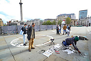 London, United Kingdom, May 18, 2021: Dayo, a British artist of Nigerian origin is drawing a portrait of Picasso outside National Portrait Gallery, nearby Trafalgar Square in London on Tuesday, May 18, 2021. (Photo by Vudi Xhymshiti/VXP)