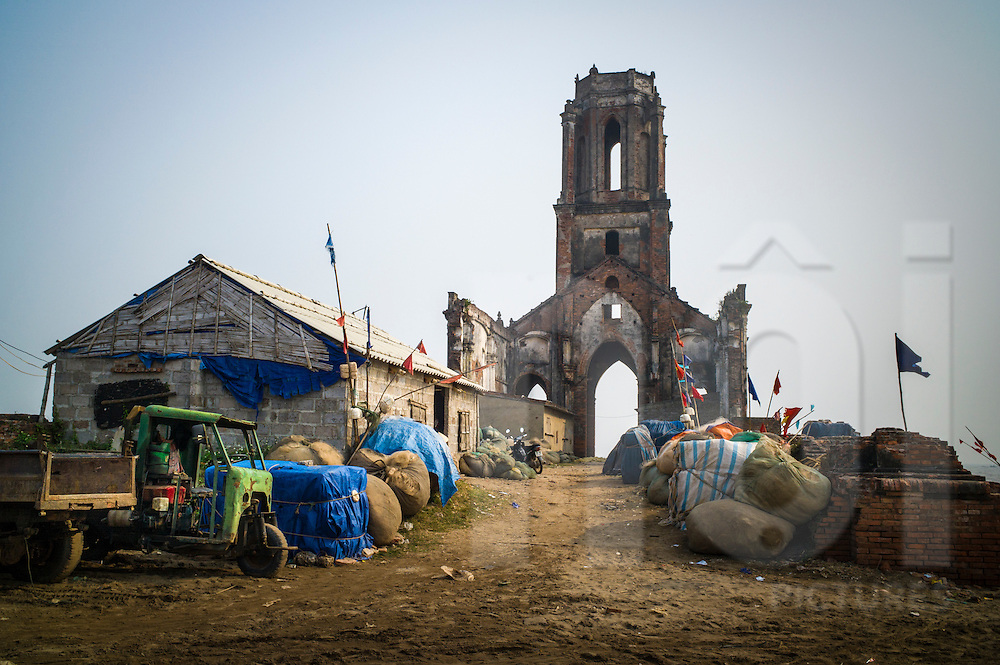 Crumbling remains of St Anna Magdalena Church (Nha tho do Nam Dinh) after years of coastal erosion in Hai Ly Commune, Hai Hau District, Nam Dinh Province, Vietnam, Southeast Asia