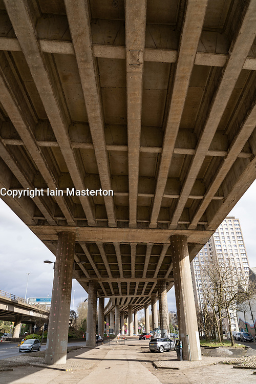 Glasgow, Scotland, UK. 23 March 2021.  Glasgow, Scotland, UK. An engineer on the viaduct during lane closures on the M8inspects the structural integrity of the concrete viaduct.  All of the bridge piers and half-joints have been marked for remedial measures and repair which will require lengthy lane closures .Iain Masterton/Alamy live News