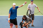USA's John Isner reacts after winning his men's quarterfinals singles match against Cypress' Marcos Baghdatis at the Citi Open ATP tennis tournament in Washington, DC, USA, 2 Aug 2013. Isner won the match 6-7, 6-4, 6-4 to advance to the semifinals on Saturday.
