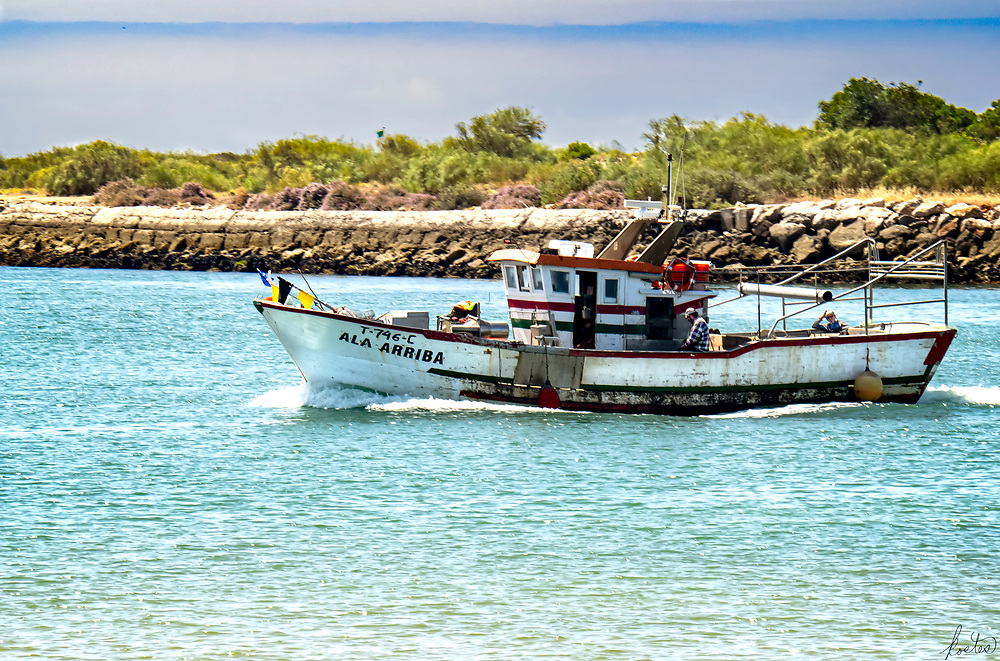 Ala Arriba fishing boat in Rio Gilão heading out to the Atlantic.