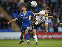 Photo: Rich Eaton.<br /> <br /> Shrewsbury Town v Fulham. Carling Cup. 28/08/2007. Fulham's Moritz Volz (r) andShrewsbury's Steve Leslie clash.