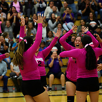 The Miyamura Patriot volleyball team celebrates winning the first set in a match against the Gallup Bengals, Thursday Oct. 4, 2018 at Miyamura High School in Gallup.