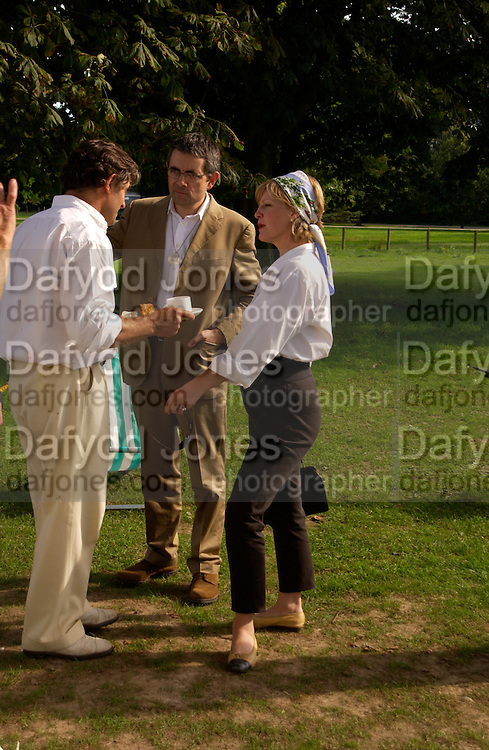 Alain de Cadanet, The Countess of March and Kirara and Rowan Atkinson, The Duke of Richmond and Gordon's X1 V The Earl of March and Kinrara's X1. Cricket match before the Goodwood Revival meeting, 2 September 2004. SUPPLIED FOR ONE-TIME USE ONLY-DO NOT ARCHIVE. © Copyright Photograph by Dafydd Jones 66 Stockwell Park Rd. London SW9 0DA Tel 020 7733 0108 www.dafjones.com