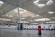 A deserted London Stanstead Airport on 16th April 2020 in London, United Kingdom. The airport is currently in a form of partial shutdown due to the Coronavirus / Covid-19 crisis / Pandemic. All shops are closed, and there are only a few flights a day, mainly for freight. The check in desks were deserted.