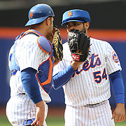 Pitcher Alex Torres, New York Mets, pitching with protective head gear, talking with catcher Anthony Recker  during the New York Mets Vs Atlanta Braves MLB regular season baseball game at Citi Field, Queens, New York. USA. 23rd April 2015. Photo Tim Clayton