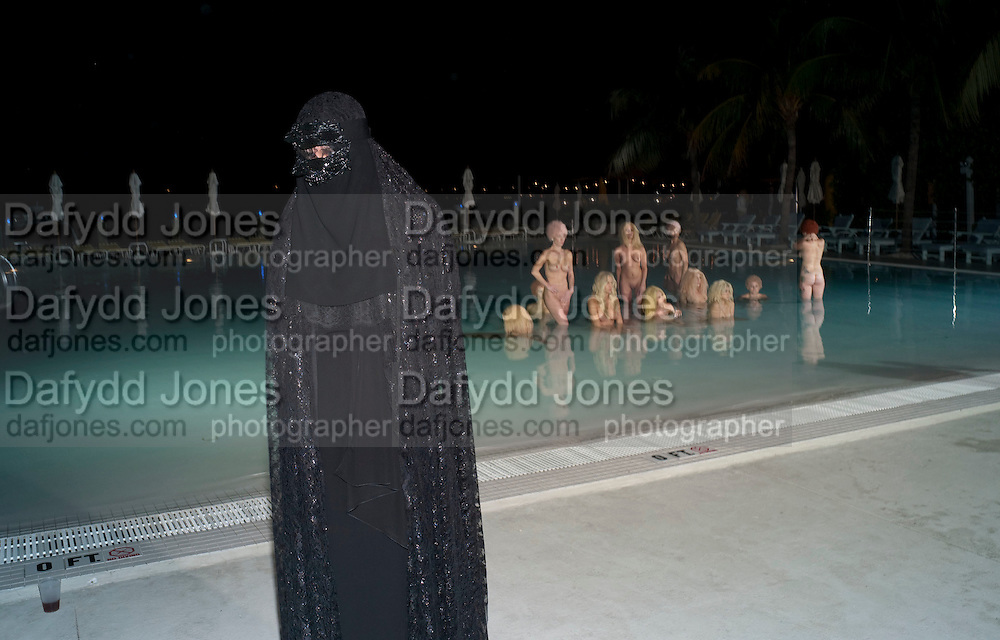 """OLYMPIA SCARRY IN CHADOR IN FRONT OF MODELS PERFORMING VANESSA BEECHCROFT INSTALLATION, Neville Wakefield and Playboy host ÒNude as MuseÓ evening art salon. Standard Hotel.  Miami. 4 December 2010. -DO NOT ARCHIVE-© Copyright Photograph by Dafydd Jones. 248 Clapham Rd. London SW9 0PZ. Tel 0207 820 0771. www.dafjones.com.<br /> OLYMPIA SCARRY IN CHADOR IN FRONT OF MODELS PERFORMING VANESSA BEECHCROFT INSTALLATION, Neville Wakefield and Playboy host """"Nude as Muse"""" evening art salon. Standard Hotel.  Miami. 4 December 2010. -DO NOT ARCHIVE-© Copyright Photograph by Dafydd Jones. 248 Clapham Rd. London SW9 0PZ. Tel 0207 820 0771. www.dafjones.com."""