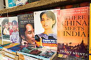 19 JUNE 2013 - YANGON, MYANMAR: Books by and about Burmese democracy icon Aung San Suu Kyi for sale on the street in Yangon. Two years ago book about her were banned by the Burmese government. The Burmese newspaper industry has enjoyed explosive growth this year after private ownership was allowed in 2013. Private newspapers were shut down under former Burmese leader Ne Win in the early 1960s. The revitalized private press is a sign of the dramatic changes sweeping Myanmar, formerly Burma, in the last three years.     PHOTO BY JACK KURTZ