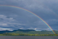 Newburgh, New York - A rainbow forms over the Hudson River and Hudson Highlands after a brief summer shower on Aug. 14, 2014. There is also a very faint second rainbow at the upper right.