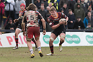 Matthew Screech of the Newport Gwent Dragons charges at Ben Toolis of Edinburgh rugby. Guinness Pro12 rugby match, Newport Gwent Dragons v Edinburgh Rugby at Rodney Parade in Newport, South Wales on Sunday 27th March 2016.<br /> pic by  Simon Latham, Andrew Orchard sports photography.