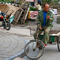 Asia, China, Guilin. Scene of life at a street corner in Guilin.