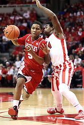 17 January 2015:   Tramique Sutherland works the top of the key against Bobby Hunter during an NCAA MVC (Missouri Valley Conference men's basketball game between the Bradley Braves and the Illinois State Redbirds at Redbird Arena in Normal Illinois