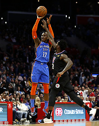 March 8, 2019 - Los Angeles, California, U.S - Oklahoma City Thunder's Dennis Schroder (17) shoots over Los Angeles Clippers' Patrick Beverley (21) during an NBA basketball game between Los Angeles Clippers and Oklahoma City Thunder Friday, March 8, 2019, in Los Angeles. (Credit Image: © Ringo Chiu/ZUMA Wire)