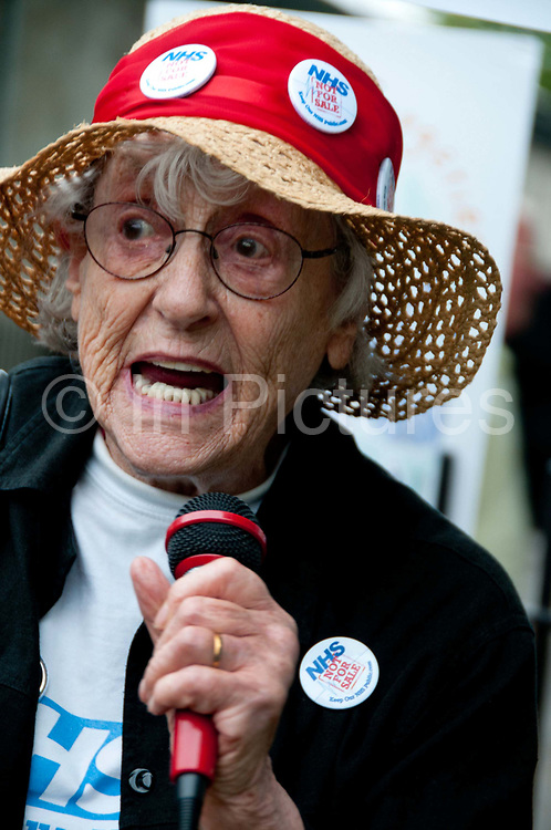 East End, London July 5th 2014. Rally and march against proposed cuts to National Health Service doctors' surgeries , specifically MPIG (Minimum Practice Income Guarantee payments) brought in to ensure practices in deprived areas had enough money to deliver high quality General Practice services. . 83 year old Shirley Murgraff, a NHS patient in Hackney, and activist.