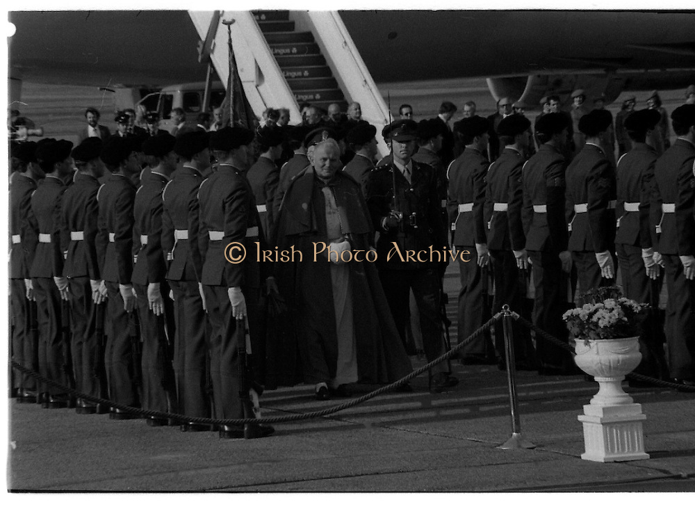 Pope John-Paul II visits Ireland..1979..29.09.1979..09.29.1979..29th September 1979..Today marked the historic arrival of Pope John-Paul II to Ireland. He is here on a three day visit to the country with a packed itinerary. He will celebrate mass today at a specially built altar in the Phoenix Park in Dublin. From Dublin he will travel to Drogheda by cavalcade. On the 30th he will host a youth rally in Galway and on the 1st Oct he will host a mass in Limerick prior to his departure from Shannon Airport to the U.S..Pictured on his arrival at Dublin Airport, Pope John-Paul II inspects a guard of honour on the tarmac.