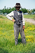 Full length portrait of elderly man standing in rural countryside area, Romania, eastern Europe 1967