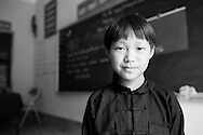 Portrait of a young ethnic boy in a classroom, northern Vietnam, Southeast Asia