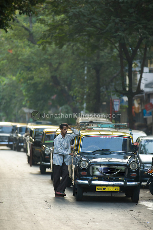 Cabs wait in line to fill up with compressed natural gas in India.