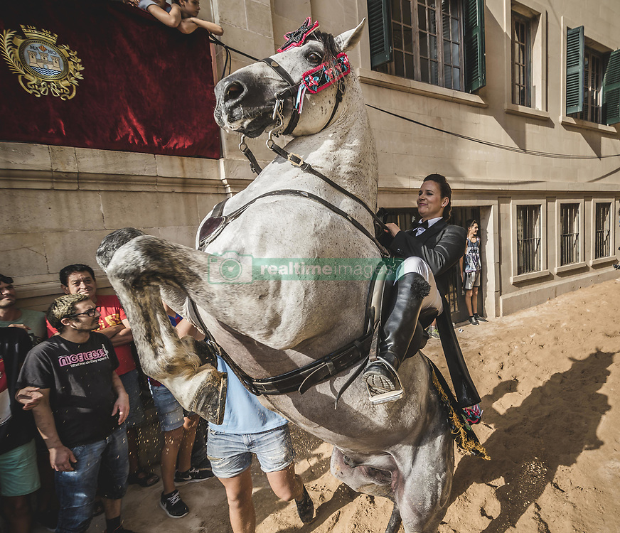 September 7, 2017 - Mahon, Balearic Islands, Spain - A 'caixer' (horse rider) rears up on her horse as they parade through the city prior to the 'Jaleo' of the traditional Gracia Festival in Mahon, celebrating its patron, Our Lady of Grace (Credit Image: © Matthias Oesterle via ZUMA Wire)