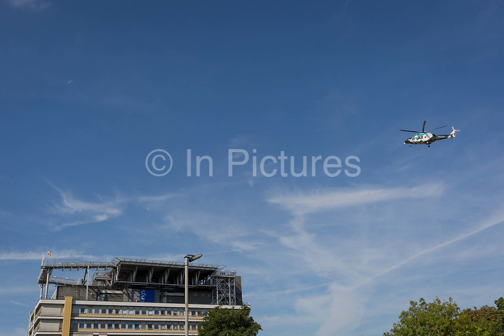 An Agusta-Westland AW-169 helicopter G-KSSC of the Kent Air Ambulance approaches the helipad of Kings College Hospital in Camberwell, on 23rd August 2019, in Camberwell, south London, England.