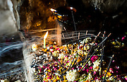 """23rd April 2015, New Delhi, India. Smoke streams from incense sticks at a shrine dedicated to Djinn worship in the ruins of Feroz Shah Kotla in New Delhi, India on the 23rd April 2015<br /> <br /> PHOTOGRAPH BY AND COPYRIGHT OF SIMON DE TREY-WHITE a photographer in delhi<br /> + 91 98103 99809. Email: simon@simondetreywhite.com<br /> <br /> People have been coming to Firoz Shah Kotla to leave written notes and offerings for Djinns in the hopes of getting wishes granted since the late 1970's. Jinn, jann or djinn are supernatural creatures in Islamic mythology as well as pre-Islamic Arabian mythology. They are mentioned frequently in the Quran  and other Islamic texts and inhabit an unseen world called Djinnestan. In Islamic theology jinn are said to be creatures with free will, made from smokeless fire by Allah as humans were made of clay, among other things. According to the Quran, jinn have free will, and Iblīs abused this freedom in front of Allah by refusing to bow to Adam when Allah ordered angels and jinn to do so. For disobeying Allah, Iblīs was expelled from Paradise and called """"Shayṭān"""" (Satan).They are usually invisible to humans, but humans do appear clearly to jinn, as they can possess them. Like humans, jinn will also be judged on the Day of Judgment and will be sent to Paradise or Hell according to their deeds. Feroz Shah Tughlaq (r. 1351–88), the Sultan of Delhi, established the fortified city of Ferozabad in 1354, as the new capital of the Delhi Sultanate, and included in it the site of the present Feroz Shah Kotla. Kotla literally means fortress or citadel."""
