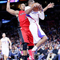 27 December 2014: Los Angeles Clippers guard Chris Paul (3) grabs the rebound against Toronto Raptors guard Kyle Lowry (7) during the Toronto Raptors 110-98 victory over the Los Angeles Clippers, at the Staples Center, Los Angeles, California, USA.
