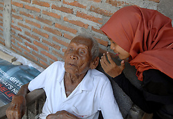 August 29, 2016 - Sragen, Central Java, Indonesia - An Indonesian man, named Mbah Gotho, claimed to be 146 years old, is the oldest human in world's history speaks to press members at his family house in Sragen, Central Java, Indonesia on August 29, 2016.  The civil registry office recorded parents born on December 31, 1870, age Mbah Gotho exceed men the oldest in the world that used to be held by French woman named Jeanne Calment lived to be 122 years old, his life Mbah Gotho have four wives and his last wife died in 1988. All of the children also had died and now his family is left ie, grandchildren, great-grandchildren, and great-great grandson. Dasril Roszandi  (Credit Image: © Dasril Roszandi/NurPhoto via ZUMA Press)