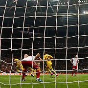Galatasaray's goalkeeper Fernando Muslera, Cristiano Marques Gomes (N3) and Eskisehirspor's Erkan Zengin (L) scores an own goal during their Turkish Super League soccer match Galatasaray between Eskisehirspor at the TT Arena at Seyrantepe in Istanbul Turkey on Saturday, 06 October 2012. Photo by TURKPIX