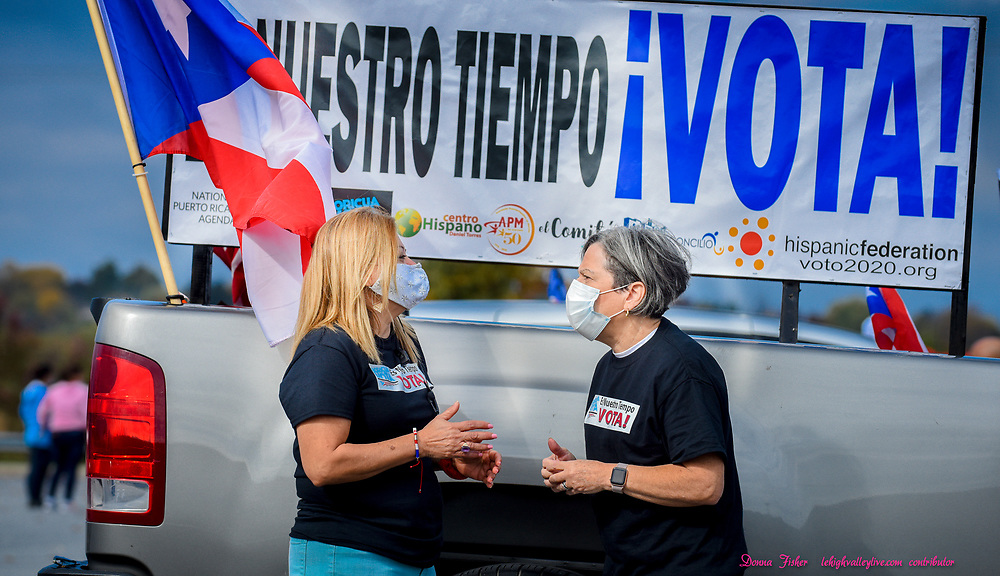 The National Puerto Rican Agenda Pennsylvania Chapter held a caravan for Latino voters on Saturday, Oct. 24, 2020  parading through the Lehigh Valley to get the message out about voting as they travel to Lancaster. Event organizers Flor Velez of Allentown, left, and Teresa Donate of Bethlehem discuss their caravan event before departure from a parking lot adjacent to Coca-Cola Park in Allentown.