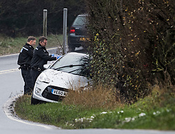 © Licensed to London News Pictures. 04/12/2020. Windsor Green, UK. Police tend to a car which has come off the road in icy conditions near Windsor Green, Suffolk as the south of England experiences snowfall for the first time this winter. Photo credit: Ben Cawthra/LNP