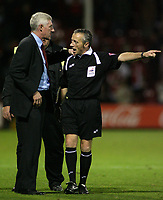 Photo: Paul Thomas.<br /> Rotherham United v Norwich City. Carling Cup. 19/09/2006.<br /> <br /> Nigel Worthington, Norwich manager (L) and referee Scott Mathieson talk after the match