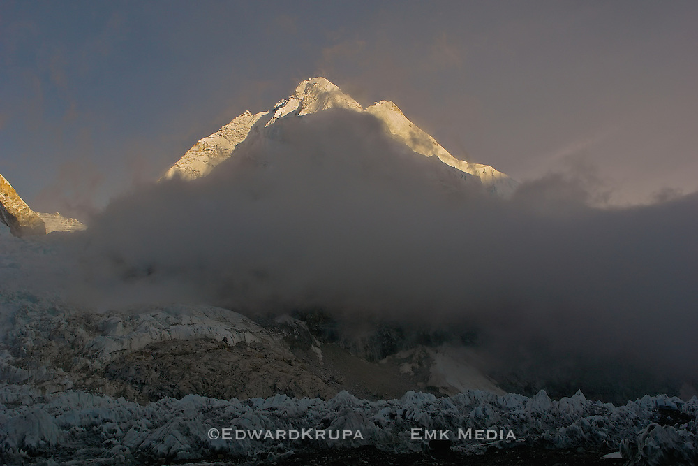 Mount Everest in early morning light with the treacherous Khumbu icefall  in foreground. Taken from south base camp in Nepal.