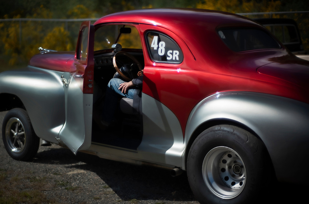 The driver of a 1958 Dodge waits to compete in a local drag racing meet, Sechelt, BC.  (2019)